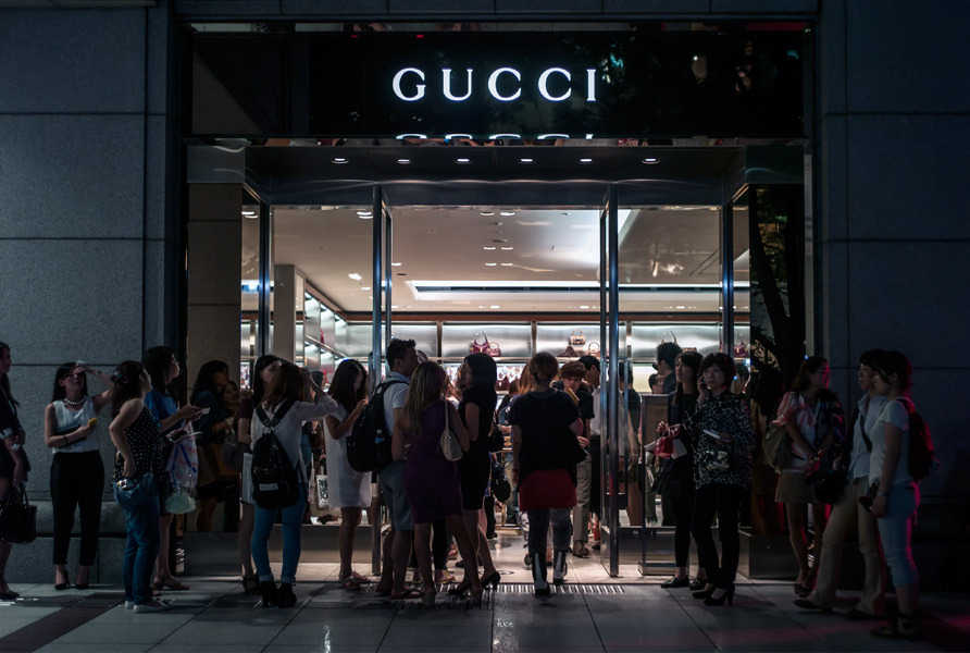 Acting rich: recession sees roaring trade in champagne and Louis Vuitton handbags